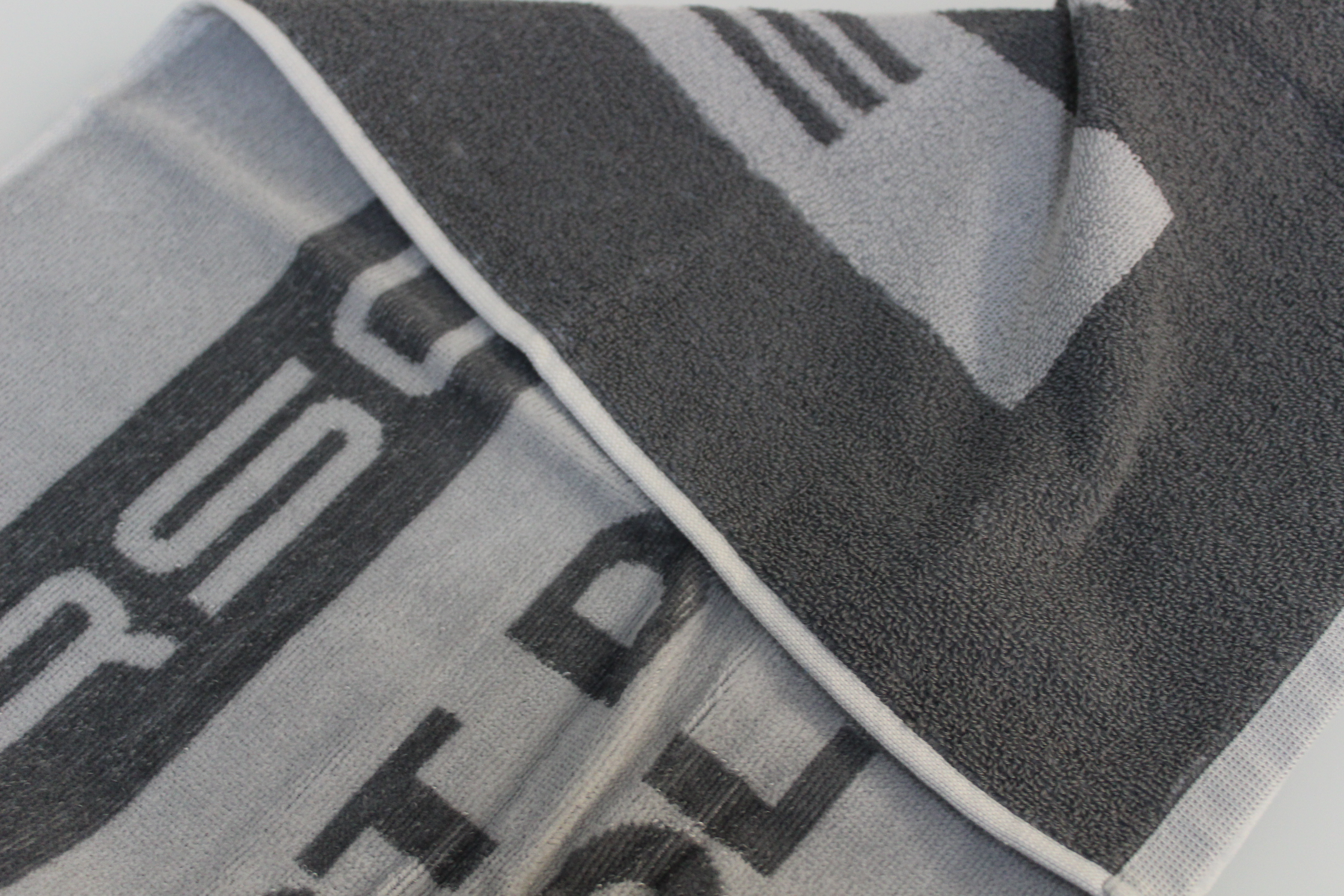 Badlakens met logo bedrukt als relatiegeschenk